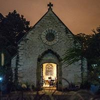 Joan of Arc Chapel at twilight with open door