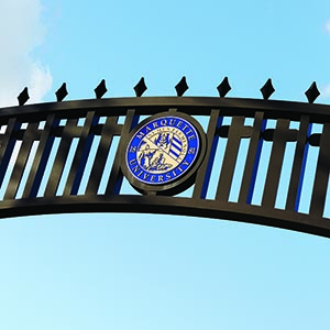 Arch with Marquette University President's Seal Logo over the Alumni Memorial Union pathway
