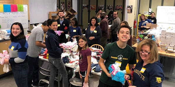 MU Club of Northern California alumni and families packing baby shower boxes