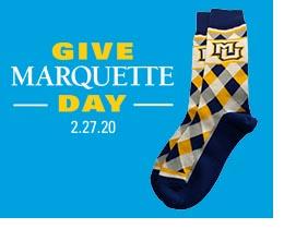 Give Marquette Day wordmark and MU socks